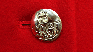 an image of a button from a Chelsea Pensioners uniform