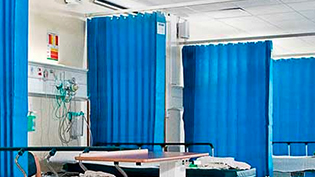 an image of beds and curtains on a hospital ward