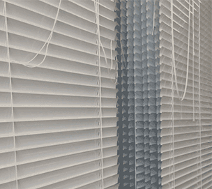 an image of venetian blinds drying after being ultrasonically cleaned