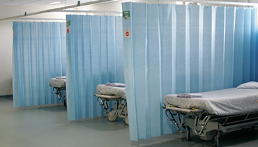 an image of Grosvenor Contracts' Disposable Cubicle Curtains in situ
