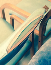 an image of a waiting room chair with a damaged seat