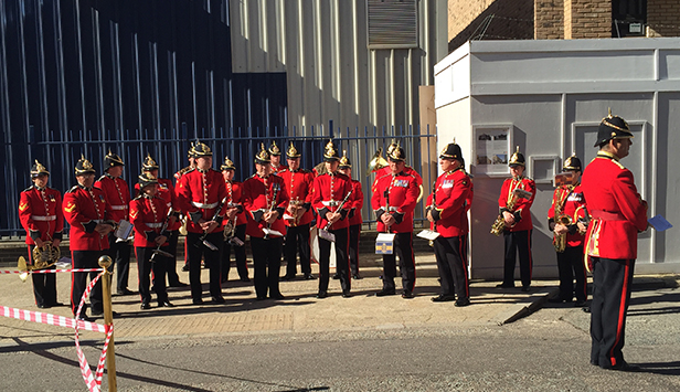 An army band plays at the re-dedication of the war memorial on Old Jamaica Road